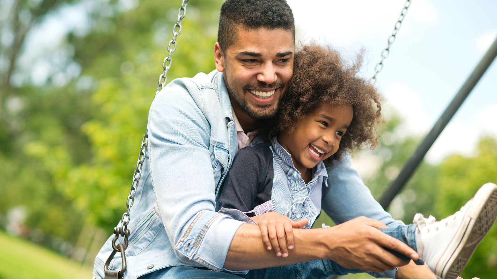father and daughter on a swing